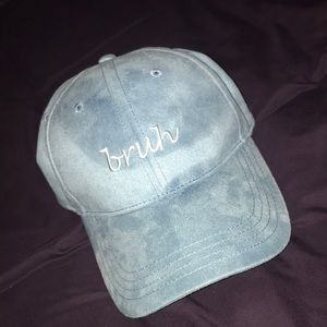 A velvet hat that has the word bruh stitched on it